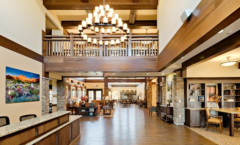 View of the entrance and lobby, hardwood floor, chandelier, vaulted ceilings,  neutral tones