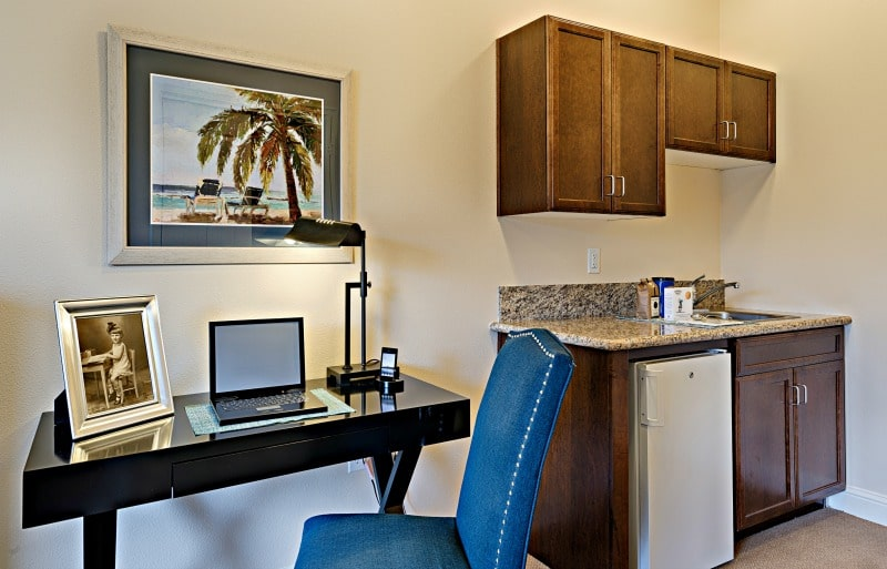Desk and kitchen area in an senior living community. Items were all purchased and procured by Warner Design Associates.