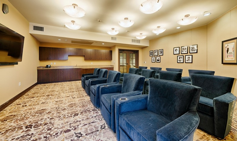 theater / movie room seats and big screen TV at Paintbrush Assisted Living and Memory Care