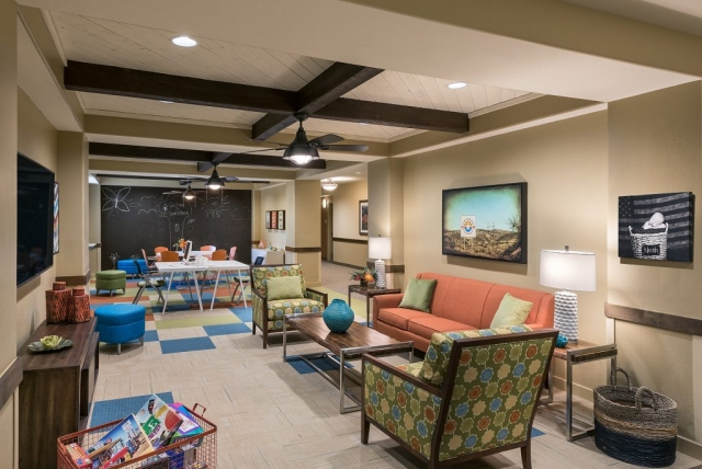 A comfortable, bright room for senior citizens and children to play together.