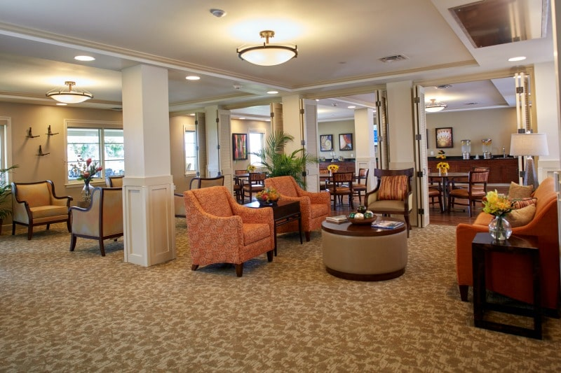 Common area with attractively designed senior living flooring and seating