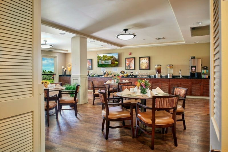 Comfortable, indoor-outdoor dining room at retirement home
