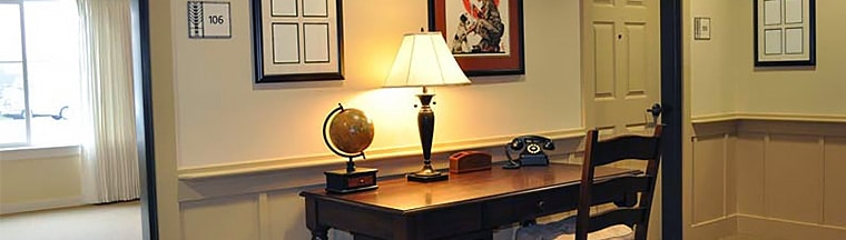 A desk with a globe and telephone at a senior living memory care community